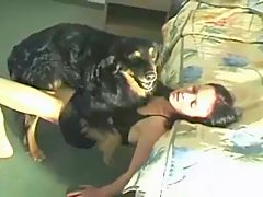 Brunette girl fucked by her dog